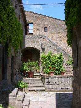 Il Ruderino is at the top of the stairs with its own semi-private courtyard